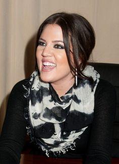 Khloe Kardashians chic, updo hairstyle