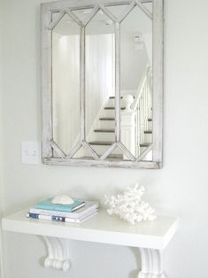 Molly Frey Design - shabby chic beach foyer, white washed mirror, wall shelf corbels, mounted console shelf...nice solution for a tight entry way.