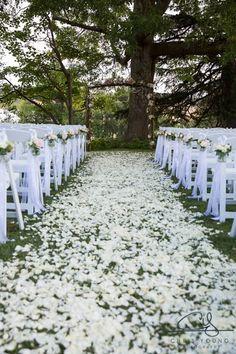 Romantic white wedding aisle