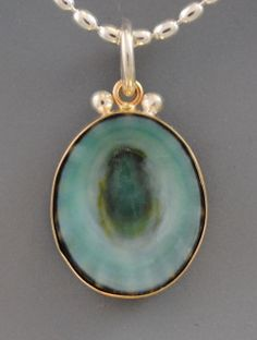 """green limpet shell from the Pacific coast of Mexico set in 14ky gold and sterling silver. 3/4"""" h."""