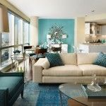 Gorgeous Blue Themed Living Room Inspire with Cream Fabric Sofa Set feat Blue Pillows Idea Near Glass Coffee Table Design and Calm Sofa Chair near White Floor Table and Huge Glass Windows a part of  under Living Room