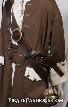 You could do a baldric too - even a very large belt would work over a bodice, since your clothes will be tight.  I wear a wide leather belt over my bodice (around my waist) which looks good too.  Baldrics be a type of belt worn over one shoulder that be used to carry a weapon, usually a cutlass. Used by pirates and seamen instead of sword belts, because