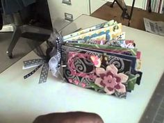 How to make a mini scrapbook out of toilet paper rolls!  I am so going to do this! KJB