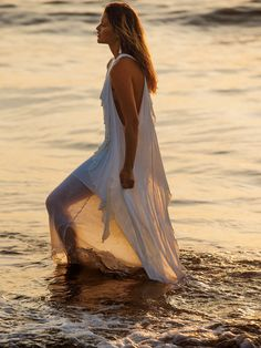 """""""I s'pose, I can't have it all my own way, can I? You can't drown in a person unless they let you."""" ― Markus Zusak, Getting the Girl - Oh My Goddess Maxi Dress   Femme and flowy maxi dress featuring an effortlessly layered look with delicate ruffles cascading throughout.    * Lightweight, semi-sheer fabrication"""