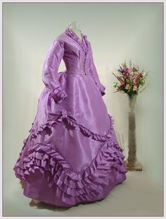 1870 lavender gown- sometimes I wish I could go back in time just for a week or so. Just to wear the dresses and go to balls. If I went back in time I would have to be rich.