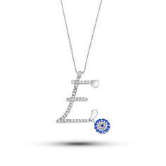 Ürün 925 ayar gümüşten imal edilmiştir.Kolye'ye E harfi yapılmiştir.Üzerine de beyaz zirkon tas işlenmiştir.