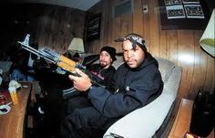"""Rapper/Actor Ice Cube posing with an AK-47. Ice Cube is  known to be gang affiliated and is also a practicing Muslim. In 2003  Ice Cube along with his group """"Westside Connection"""" released  their 2nd studio album titled """"Terrorist Threats""""."""