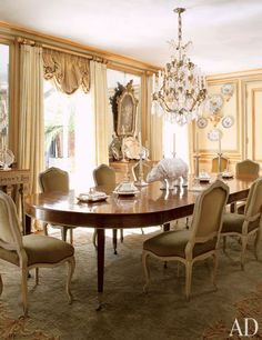 Channeling the look of French hôtels particuliers, architect Jorge Elias created a stunning São Paulo home that flawlessly melds neoclassical style with tropical flair. In the grand dining room, 1940s Jansen chairs surround an 18th-century table from Florian Papp. (February 2012)
