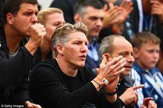 Schweinsteiger (centre) supports girlfriend Ivanovic as the Serbian battles through in the French Open.
