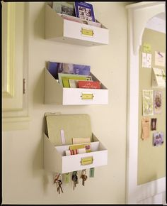 Wall-mounted bins labeled with family members names help things from getting misplaced.