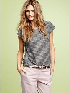 from the Gap. I like the tucked in shirt w/ belt. And her easygoing hair! Needs a necklace.