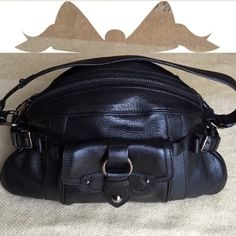 🕔{rare} CÈLINE BLACK LEATHER BAG Authentic Celine shoulder bag has Silver-tone hardware, with single strap. Single pocket in the front with snap closure. Woven interior lining with wall pockets -one zips. Zipper closure. Minor scratches and discoloration on hardware. Own your very own Céline bag for a great price. Dust bag included. Authentic. WIDTH:13.5\