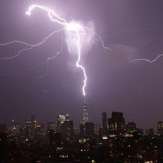 "BBC News (@bbcnews) on Instagram: ""A bolt of lightning strikes the spire of One World Trade Center in lower Manhattan as a thunder…"""