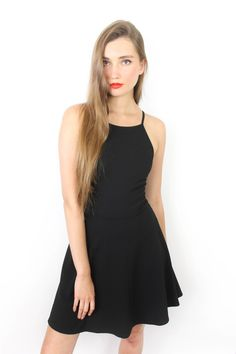Cute flowy and fun black dress! Wear day and night! Available now at www.modlook29.com!