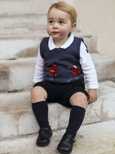 One of the three official Christmas images taken in late November showing Prince George in the courtyard at Kensington Palace.