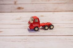 A personal favorite from my Etsy shop https://www.etsy.com/listing/287182733/vintage-1970s-red-tonka-truck-semi-truck