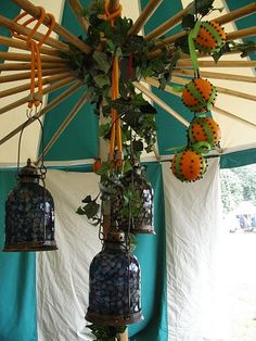 Great lighting/decor ideas for the tents. What's even better is the bottles are nearly opaque so you can put LED candles inside (especially ones with flicker fx) and thus no fire hazard!