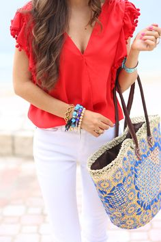 Spring / Summer - street chic style - beach style - white skinnies + woven tote + bright red v-neck top with pom pom sleeves