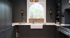 Source: Devol Kitchens When working with a historic building and you can't change the windows or fit a full depth counter... make it work!
