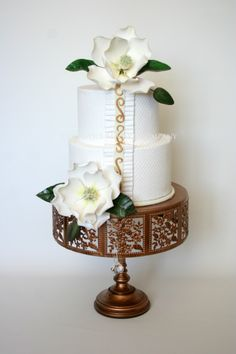 Wedding Cakes. White wedding cake with creamy, buttery frosting.  The flowers are fresh Gardenias on the cake.