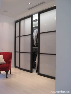 Sliding doors for a closet. This would look awesome with lights inside the  closet.