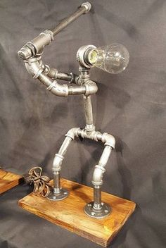 30 industrial diy pipe lamp design ideas lamps can be one of the most rewardful diy projects in the world … Lampe Steampunk, Luminaire Original, Retro Lampe, Lampe Tube, Pipe Decor, Pipe Lighting, Industrial Pipe, Industrial Lighting, Industrial Bookshelf