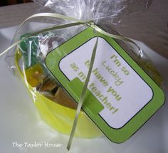 Teacher St. Patrick's Day Gift....We just picked up this little basket from the Dollar tree, they were in a package of four for a buck. Then added some green M&M's, Rollos and Hershey nuggets in the bucket.