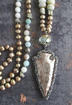 Mix of posh freshwater pearls and rugged semi precious stone beads knotted with a bedazzled carved arrowhead pendant! Artisan bronze and sterling silver accents. Great year-round neutral layering necklace :) Measures 30 long ... Pendant drop adds an additional 4. *Shown layered with other necklaces also available in my shop... As with all of my jewelry, I ONLY use TOP quality materials in my work. The result is well worth it and it shows! ORIGINAL LIST DATE: May 12, 2016* Often imitated…