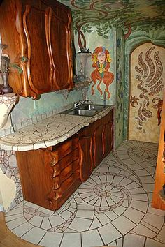 Mosaic kitchen by Lance Jordan - I love the wood cabinets and the whimsical shapes of the doors!