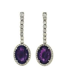 A pair of amethyst and diamond pendent earrings Each oval-cut amethyst and brilliant-cut diamond cluster to a brilliant-cut diamond line suspension, mounted in 18ct white gold, post fittings, London hallmark, 5.1cm long