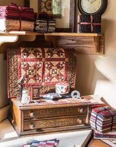 A small quilt hides Pam's TV, which sits on an antique thread cabinet in her sewing room.