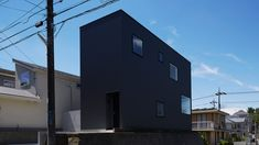 Black corrugated metal encases loft-inspired interiors of Japanese house by TakaTina