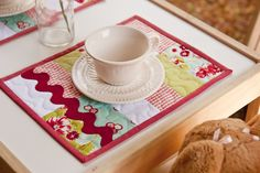 Cute simple appliques, variations in quilting pattern on a simple placemat base