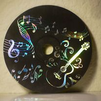 Scratchboard CD Paint them with black  acrylic paint, let dry, then use a sharp object to scratch a picture into it.