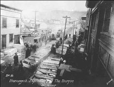 5 railroad carloads of coffins arrived in Monongah the day after the explosion.  They were hardly enough.  The day before, at the tender age of twelve, (Carrie) Mae Davis had to wade through coffins like those above to walk home from school.  The body parts of burned and mangled miners laid in wooden boxes for all to see.  This gruesome display continued to haunt her for nearly seventy years as she reminded her coal-mining son and grandsons of the danger below—till the day she died.