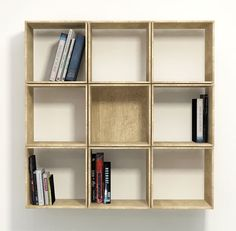 The hinged boxes of this bookcase by Korean furniture designer Lee Sehoon can be spun round to create a neat grid or a scattered circle.