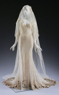 John Galliano, wedding dress and veil, made for Kate Moss - Silk chiffon, silk georgette and silk tulle, hand-embroidered with sequins and pearls