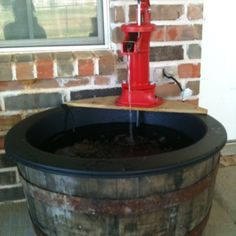 """Whiskey barrel fountain my sweet husband made for me. All materials purchased from lowes. Whiskey barrel Barrel koi pond liner 30-50 GPM pond pump 1/2"""" pond pump tubing Fence picket ( cut to fit on top of barrel) Pitcher pump ( unbolt to take out washers and unscrew rubber stop I side) Place pond liner in barrel, cut fence board to place on top of barrel.use wood screws to mount board. Also drill hole underneath where pump sits on the board for tubing to come up into the pitcher pump.mount…"""