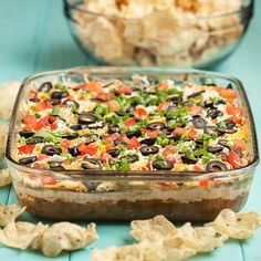 7-Layer Mexican Dip. Easy, no-bake recipe thats a winner every time! Its the first dip to go at any party. Perfect for Game Day!