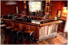 If I were to ever want to build a bar in our house, I would want it to look like this, rustic barwood, pipe footrail, live edge countertop.