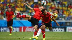 Thiago Silva of Brazil collides with Oribe Peralta and Giovani dos Santos of Mexico 2014 FIFA World Cup