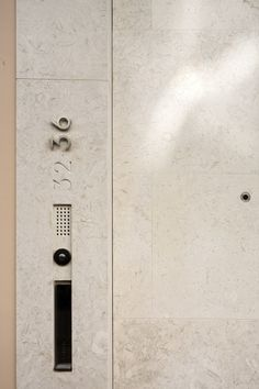 Well integrated signage an door bell. House in Lisbon by ARX Arquitectos.