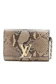 b5003bd0dda5ea Louis Vuitton Beige Python Chain Louise Clutch Bag. Get the trendiest Clutch  of the season. Tradesy