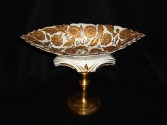 embossed/gold leafed china boat-shaped dish, brass stick