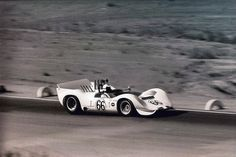 Jim Hall in the Chaparral 2C at Riverside, 1965. According to former Chaparral mechanic, Benjamin Sweet, the 2C introduced the first aluminum chassis for Chaparral. This chassis was the basis for the 2E and 2G cars.