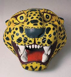 Jaguar Mask  Danza del Tigre, Oaxaca    10 inches, painted wood    One of the most popular animal subjects for masquerade is the tigre, the rural Mexican word for jaguar. Though now an endangered species, it is the largest new world cat and was both feared and worshipped in pre-conquest times. The tigre was believed to be the animal-soul companion of the important Aztec diety Tezcatlipoca, a nocturnal god who could bestow or withhold riches and good luck at will