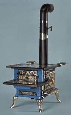 Phillips & Buttorff Mfg Co. cast iron and nickel Model Enterprise salesman sample stove, 13 3/4'' h., 16'' w.