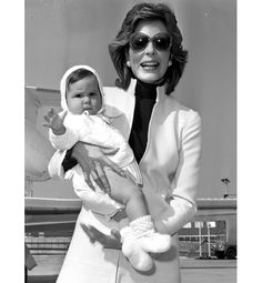 Princess Salimah Aga Khan is shown here arriving at Heathrow in London with her then-7-month-old daughter Zahra