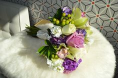 Bright bouquet of greens, purple, and whites, Striking in color and design.