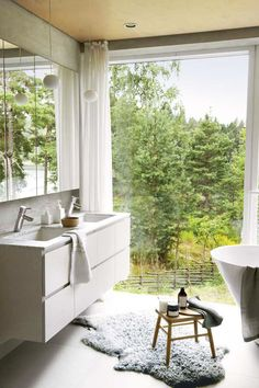 Minimalist home in the middle of untouched nature in Sweden #bathroom #bath #window #view #interior #design #decor #home #room #style #idea #inspiration #cozy #cool #beautiful #scandinavian